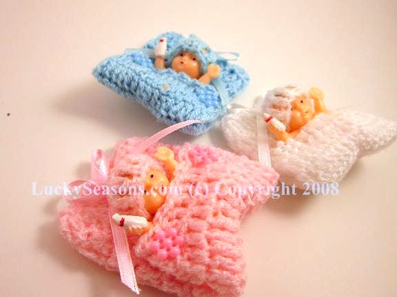 "2.25 "" knitted baby in a blanket"